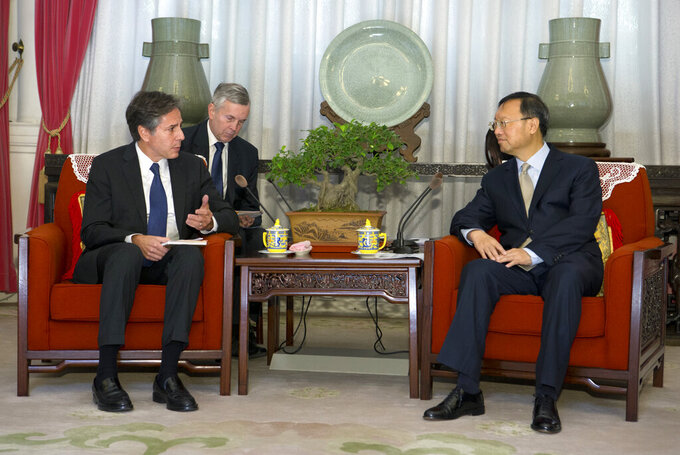 FILE - In this Oct. 8, 2015, file photo, then U.S. Deputy Secretary of State Antony Blinken, left, speaks with Chinese State Councilor Yang Jiechi during a meeting at the Zhongnanhai Leadership Compound in Beijing. Senior Chinese foreign policy adviser Yang and now Secretary of State Blinken held a phone call Friday, June 11, 2021, that revealed wide divisions in a number of contentious areas, including the curtailing of freedoms in Hong Kong and the mass detention of Muslims in the northwestern Xinjiang region. (AP Photo/Mark Schiefelbein, Pool, File)