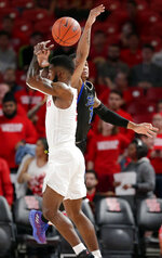 Tulsa guard Elijah Joiner (3) knocks the ball away from Houston guard Corey Davis Jr. (5) on an attempted pass during the first half of an NCAA college basketball game Wednesday, Jan. 2, 2019, in Houston. (AP Photo/Michael Wyke)