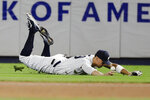New York Yankees' Aaron Judge loses control of a ball hit by Los Angeles Angels' Albert Pujols for a single fifth inning of a baseball game Wednesday, Sept. 18, 2019, in New York. (AP Photo/Frank Franklin II)