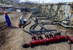 FILE - In this March 29, 2013, file photo, a worker helps monitor water pumping pressure and temperature, at an oil and natural gas extraction site, outside Rifle, on the Western Slope of Colorado. A federal judge has ruled that the Trump administration's leading steward of public lands has been serving unlawfully and blocked him from continuing in the position. U.S. District Judge Brian Morris said Friday, Sept. 25, 2020, that U.S. Bureau of Land Management acting director William Perry Pendley was never confirmed to the post by the U.S. Senate and served unlawfully for 424 days. (AP Photo/Brennan Linsley, File)