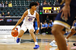 Boise State guard RayJ Dennis (10) looks to get through the Georgia Tech defense during the first half of an NCAA college basketball game Sunday, Dec. 22, 2019, in Honolulu. (AP Photo/Marco Garcia)