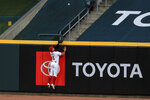 Cincinnati Reds' Nick Senzel (15) leaps at the wall as he is unable to catch the two-run home run hit by Cleveland Indians' Franmil Reyes (32) in the eighth inning during a baseball game at in Cincinnati, Tuesday, Aug. 4, 2020. (AP Photo/Aaron Doster)