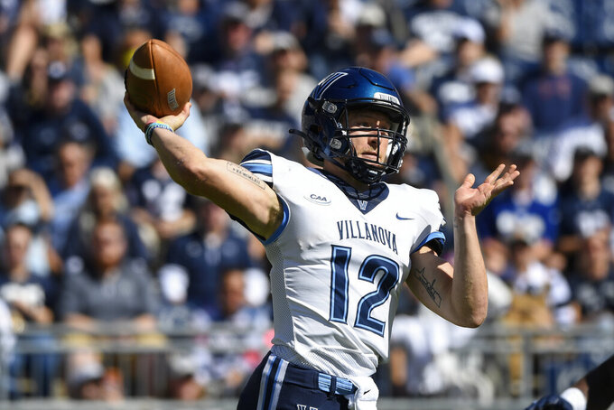 Villanova quarterback Daniel Smith (12) passes against Penn State in the first quarter touchdown during an NCAA college football game in State College, Pa., on Saturday, Sept. 25, 2021. (AP Photo/Barry Reeger)