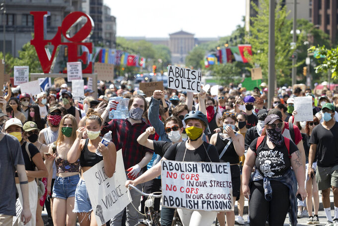Protesters rally at LOVE Park in Philadelphia on Thursday, June 4, 2020 as the protests sparked by the death of George Floyd continue Floyd died after being restrained by Minneapolis police officers on May 25. (Charles Fox/The Philadelphia Inquirer via AP)