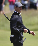 Rory McIlroy, of Northern Ireland, walks along the seventh green during a practice round for the U.S. Open Golf Championship, Tuesday, June 12, 2018, in Southampton, N.Y. (AP Photo/Julie Jacobson)