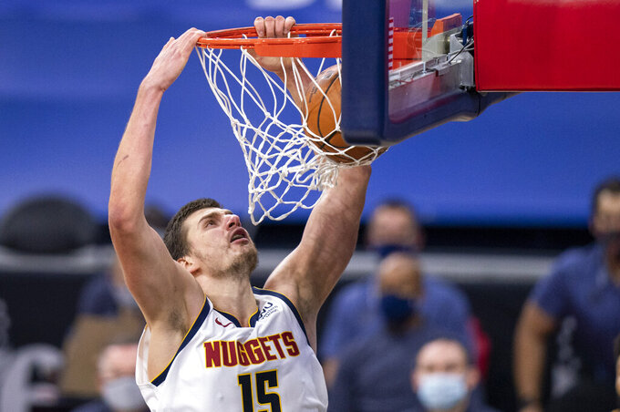 Denver Nuggets' Nikola Jokic dunks the ball during the first half of an NBA basketball game against the Philadelphia 76ers, Saturday, Jan. 9, 2021, in Philadelphia. (AP Photo/Chris Szagola)