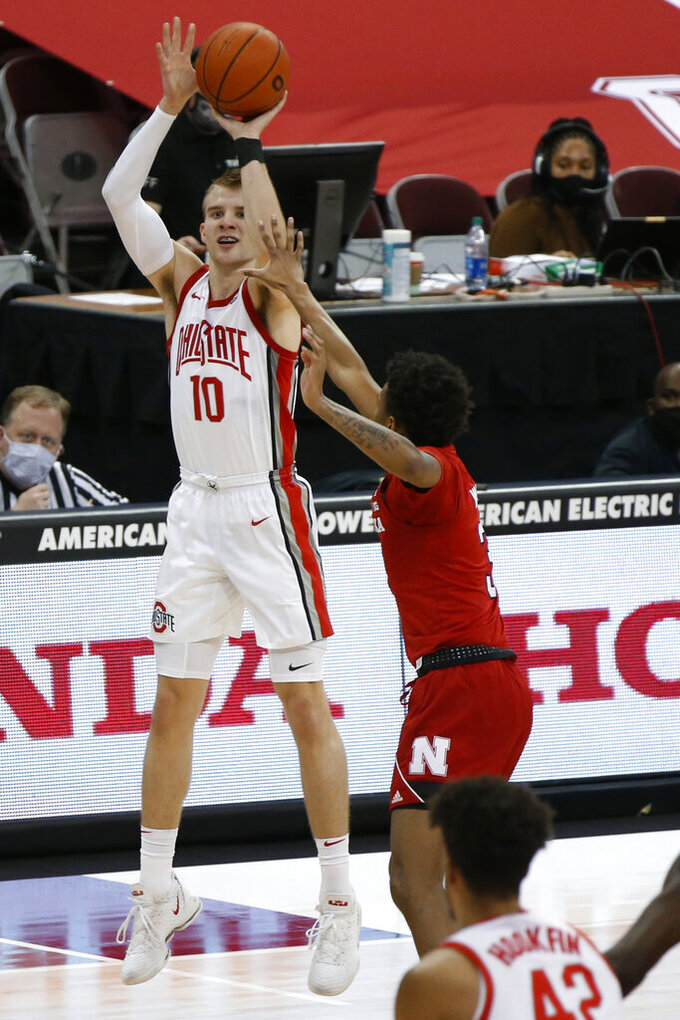 Ohio State's Justin Ahrens, left, shoots over Nebraska's Elijah Wood during the second half of an NCAA college basketball game Wednesday, Dec. 30, 2020, in Columbus, Ohio. (AP Photo/Jay LaPrete)