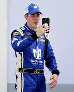 NASCAR Daytona 500 auto race pole sitter, Alex Bowman takes a selfie photo in Victory Lane after his qualifying run at Daytona International Speedway, Sunday, Feb. 11, 2018, in Daytona Beach, Fla. (AP Photo/Terry Renna)
