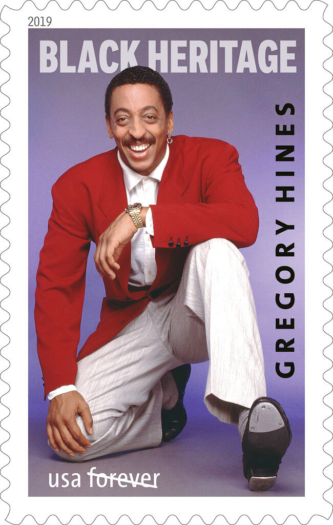 This undated image provided by the U.S. Postal Service shows a Black Heritage Series stamp with a 1988 photograph of Gregory Hines on it. The U.S. Postal Service is honoring entertainer Hines with the stamp. Acting chief postal inspector Gary Barksdale will host the first day of issue ceremony Monday, Jan. 28, 2019, at the Peter Norton Symphony Space in New York. Hines, who was known for his unique style of tap dancing, won a Tony Award in 1992 for