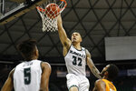 Hawaii guard Samuta Avea (32) makes a slam dunk over UTEP during the second half of an NCAA college basketball game Sunday, Dec. 22, 2019, in Honolulu. (AP Photo/Marco Garcia)