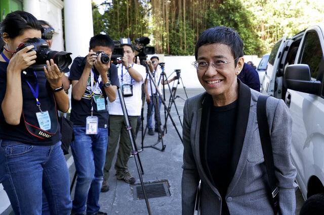 """FILE - In this April 3, 2019, file photo, Rappler CEO and Executive Editor Maria Ressa arrives at the Court of Tax Appeals in metropolitan Manila, Philippines. Ressa, who has aggressively covered Philippine President Rodrigo Duterte's administration, is bracing for a verdict in a libel case and says she sees the upcoming decision as """"an existential moment"""" for democracy in the Philippines. A Manila court is expected to rule in the case Monday, June 15, 2020. (AP Photo/Aaron Favila, File)"""