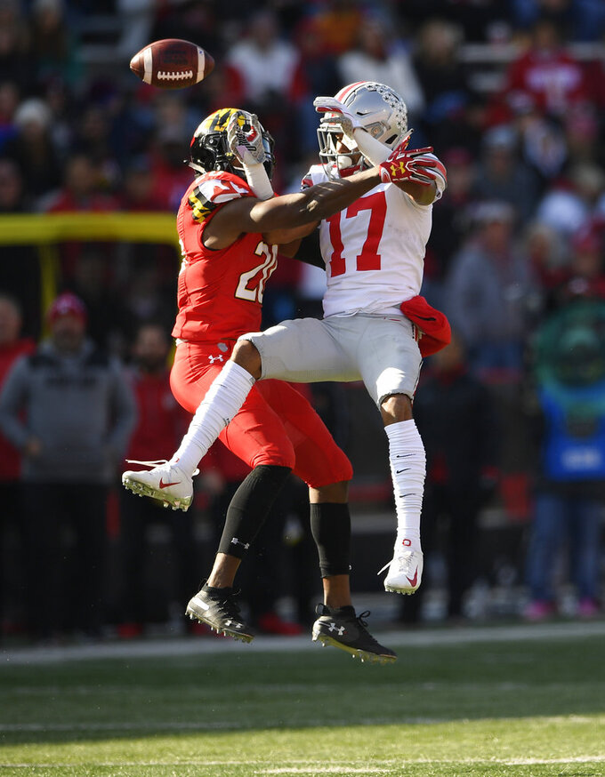 Maryland defensive back Antwaine Richardson, left breaks up a pass intended for Ohio State wide receiver Chris Olave (17) during the first half of an NCAA football game, Saturday, Nov. 17, 2018, in College Park, Md. (AP Photo/Nick Wass)