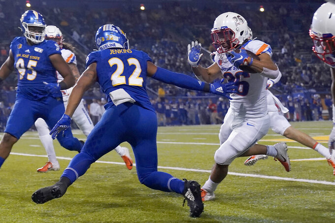 FILE - In this Saturday, Nov. 2, 2019 file photo, Boise State's Avery Williams (26) races past San Jose State's Tre Jenkins (22) on his punt return for a touchdown during the first half of an NCAA college football game, in San Jose, Calif. No. 25 San Jose State will face perennial conference powerhouse Boise State in the Mountain West championship on Saturday, Dec. 19, 2020 in Las Vegas. The game is usually played on the higher seed's home field but this year it will be held at Sam Boyd Stadium. (AP Photo/Tony Avelar, File)