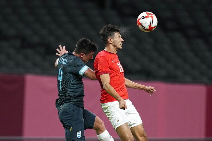 Argentina's Hernan De LaFuente, left, and Egypt's Ahmed Fotouh fight for the ball during a men's soccer match at the 2020 Summer Olympics, Sunday, July 25, 2021, in Sapporo, Japan. (AP Photo/Silvia Izquierdo)