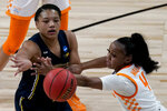 Michigan forward Naz Hillmon passes under pressure from Tennessee guard Jordan Walker (4) during the second half of a college basketball game in the second round of the women's NCAA tournament at the Alamodome in San Antonio, Tuesday, March 23, 2021. Michigan won 70-55. (AP Photo/Charlie Riedel)