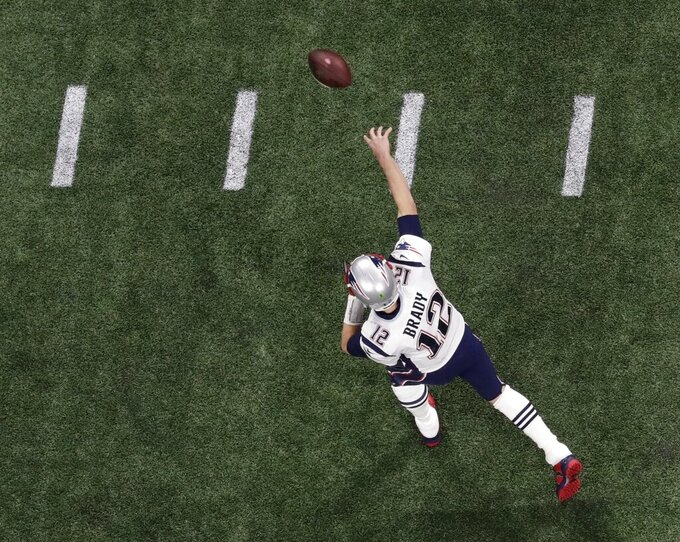 New England Patriots' Tom Brady (12) throws before the NFL Super Bowl 53 football game between the Los Angeles Rams and the New England Patriots, Sunday, Feb. 3, 2019, in Atlanta. (AP Photo/Morry Gash)