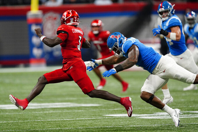 Mississippi defensive lineman Sam Williams (7) chase's down Louisville quarterback Malik Cunningham (3) during the second half of an NCAA college football game Monday, Sept. 6, 2021, in Atlanta. (AP Photo/John Bazemore)