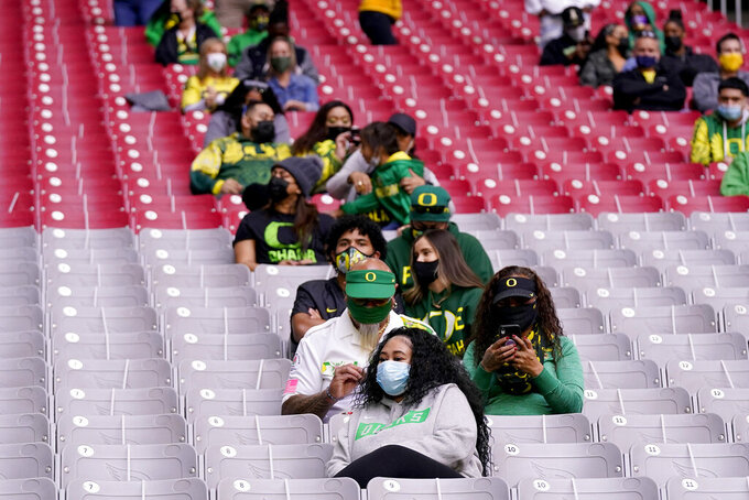 Oregon fans watch during the first half of the Fiesta Bowl NCAA college football game against Iowa State, Saturday, Jan. 2, 2021, in Glendale, Ariz. (AP Photo/Ross D. Franklin)