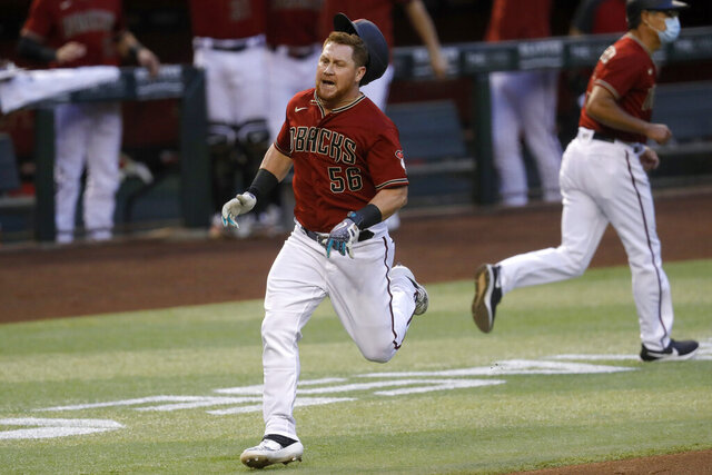 Arizona Diamondbacks' Kole Calhoun (56) rounds the bases after hitting an inside-the-park two-run home run during the fourth inning of a baseball game against the Houston Astros Wednesday, Aug. 5, 2020, in Phoenix. (AP Photo/Matt York)
