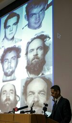 FILE -- In this Thursday, June 6, 2019 file photo New Hampshire Senior Assistant Attorney General Jeffery Strelzin stands in front of projected photos of convicted killer Terry Peder Rasmussen during a news conference at the Department of Safety, in Concord, N.H. A graveside service is planned in New Hampshire, Saturday, Nov. 9, 2019, for Marlyse Honeychurch, 24, and 6-year-old Marie Vaughn, two suspected victims of Rasmussen who were identified decades after their remains were discovered in a barrel in 1985. Authorities believe Rasmussen, who died in a California prison in 2010, is responsible for the deaths. (Michael Pezone/The Concord Monitor via AP, File)