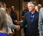 Jon Huntsman Jr. talk with employees and clients at KKOS Lawyers and K&E CPAs in their offices in Cedar City, Utah, shortly after announcing that he is running for a third term as Utah's governor Thursday, Nov. 14, 2019. (Steve Griffin/The Deseret News via AP)