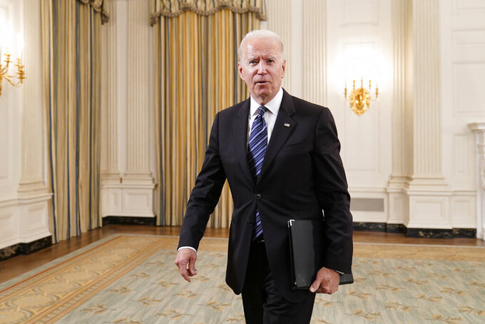 President Joe Biden walks out of the State Dining room after an event with Attorney General Merrick Garland at the White House in Washington, Wednesday, June 23, 2021, to discuss gun crime prevention strategy. (AP Photo/Susan Walsh)