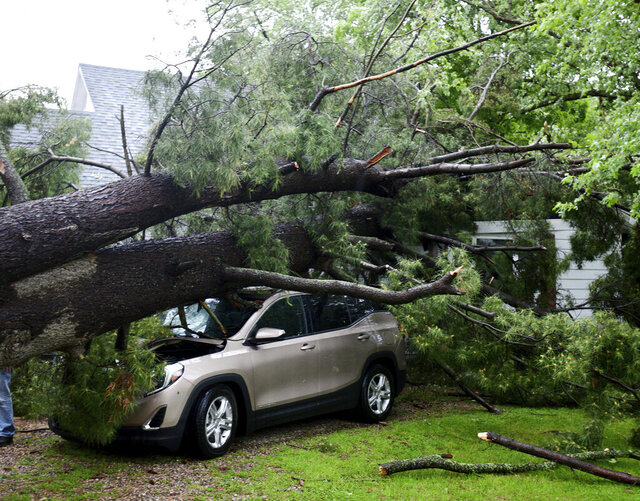 Storm damage is seen at a home on Main Street in Concord, Mich., on Wednesday, June 10, 2020. Strong storms with heavy winds swept across Jackson County causing power outages, downing trees and damaging property.  (J. Scott Park/Jackson Citizen Patriot via AP)