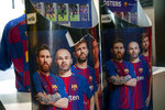 Posters of Lionel Messi and Barcelona teammates are displayed in a souvenir store in downtown Madrid, Spain, Friday, Aug. 6, 2021. Messi is leaving after leading Barcelona into its most glorious years. He helped the club win 35 titles, including the Champions League four times, the Spanish league 10 times, the Copa del Rey seven times and the Spanish Super Cup eight times. (AP Photo/Andrea Comas)