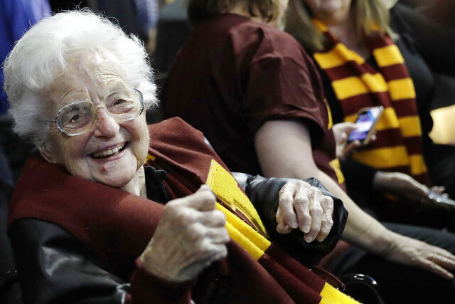FILE - In this March 22, 2018 file photo, Sister Jean Dolores Schmidt sits with other Loyola-Chicago fans during the first half of a regional semifinal NCAA college basketball game against Nevada in Atlanta. Even to Sister Jean, the lovable nonagenarian nun who became a star during Loyola Chicago's stunning run to the Final Four two years ago, this is new territory. The COVID-19 pandemic has brought big chunks of the world to a near standstill. And at 100 years old, this is new territory for Sister Jean Dolores Schmidt. (AP Photo/David Goldman, File)