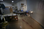 Blood is seen on a hospital floor in Atareb, a town in rural western Aleppo, Syria, Sunday, March 22, 2021. Artillery shells fired from government areas killed at least five civilians and wounded medical staff when they landad in front of the hospital. (AP Photo/Ghaith Alsayed)