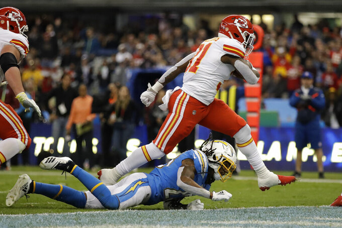 Kansas City Chiefs running back Darrel Williams, above, scores a touchdown during the second half of an NFL football game against the Los Angeles Chargers, Monday, Nov. 18, 2019, in Mexico City. (AP Photo/Marcio Jose Sanchez)