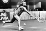 FILE - In this March 17, 1977, file photo, Rosie Casals of Sausalito, Calif., catches up with the ball for a backhand return during her match with Mary Hamm at the Virginia Slims tournament in Philadelphia. Casals won, 6-2, 6-4. It's the 50th anniversary of Billie Jean King and eight other women breaking away from the tennis establishment in 1970 and signing a $1 contract to form the Virginia Slims circuit. That led to the WTA Tour, which offers millions in prize money. Casals was one of then nine. (AP Photo/Rusty Kennedy, File)
