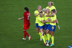 Sweden's Stina Blackstenius, center, celebrates scoring the opening goal against Canada with teammates during the women's final soccer match at the 2020 Summer Olympics, Friday, Aug. 6, 2021, in Yokohama, Japan. (AP Photo/Kiichiro Sato)