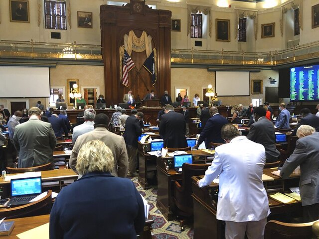 South Carolina lawmakers stand for eight minutes and 46 seconds of silence in honor of George Floyd, killed by a Minneapolis police officer, during a session of the South Carolina House on Wednesday, June 24, 2020, in Columbia, South Carolina. The leader of the conservative, Republican-dominated chamber asked for