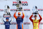 Scott Dixon, center, celebrates winning the IndyCar Series auto race at Mid-Ohio Sports Car Course with second place finisher teammate Felix Rosenqvist, left, and third place finisher Ryan Hunter-Reay, Sunday, July 28, 2019 in Lexington, Ohio. (AP Photo/Tom E. Puskar)