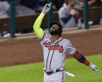Atlanta Braves' Marcell Ozuna gestures as he steps on home plate after hitting a home run during the eighth inning of the team's baseball game against the Washington Nationals in Washington, Friday, Sept. 11, 2020. (AP Photo/Manuel Balce Ceneta)