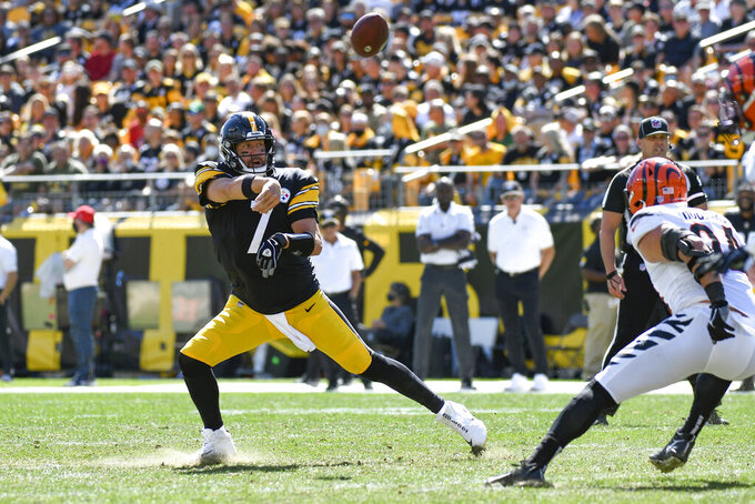 Pittsburgh Steelers quarterback Ben Roethlisberger (7) gets a pass off past Cincinnati Bengals defensive end Sam Hubbard (94) during the first half an NFL football game, Sunday, Sept. 26, 2021, in Pittsburgh. (AP Photo/Don Wright)