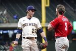 Milwaukee Brewers' Christian Yelich talks to Philadelphia Phillies' Bryce Harper during the eighth inning of a baseball game Wednesday, Sept. 8, 2021, in Milwaukee. (AP Photo/Morry Gash)