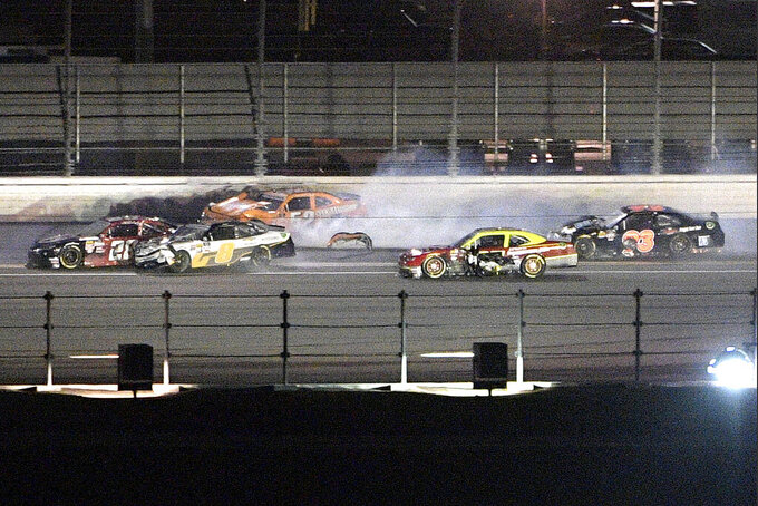 David Starr (52) loses part of the car after being involved in a multi-car accident with Shane Lee (28), Sheldon Creed (8), Chris Cockrum and Scott Lagasse Jr. (93) on the backstretch during the NASCAR Xfinity Series auto race at Daytona International Speedway, Friday, July 5, 2019, in Daytona Beach, Fla. (AP Photo/Phelan M. Ebenhack)