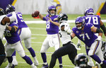 Minnesota Vikings quarterback Kirk Cousins (8) throws a pass during the first half of an NFL football game against the Jacksonville Jaguars, Sunday, Dec. 6, 2020, in Minneapolis. (AP Photo/Bruce Kluckhohn)