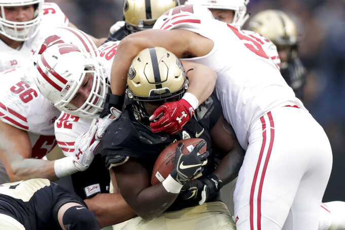 Wisconsin defensive end Matt Henningsen (92) and linebacker T.J. Edwards (53) tackle Purdue running back D.J. Knox (1) during the first half of an NCAA college football game in West Lafayette, Ind., Saturday, Nov. 17, 2018. (AP Photo/Michael Conroy)