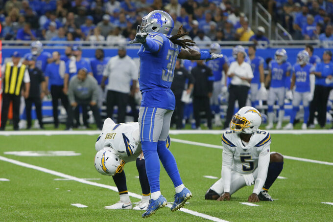 Los Angeles Chargers punter Ty Long (1) reacts to missing a field goal as Detroit Lions defensive back Dee Virgin (30) reacts in the second half of an NFL football game in Detroit, Sunday, Sept. 15, 2019. (AP Photo/Duane Burleson)