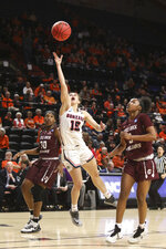 Gonzaga's Jessie Loera (15) drives to the basket through Little Rock's Raeyana DeGray (30) and Terrion Moore (3) during the first half of a first-round game of the NCAA women's college basketball tournament in Corvallis, Ore., Saturday, March 23, 2019. (AP Photo/Amanda Loman)