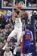 Indiana Pacers' Domantas Sabonis (11) dunks as Detroit Pistons' Jon Leuer (30) watches during the first half of an NBA basketball game, Monday, April 1, 2019, in Indianapolis. (AP Photo/Darron Cummings)