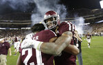 Texas A&M wide receiver Kendrick Rogers, right, celebrates with Charles Oliver (21) after an NCAA college football game against LSU Saturday, Nov. 24, 2018, in College Station, Texas. Texas A&M won 74-72 in seven overtimes.(AP Photo/David J. Phillip)
