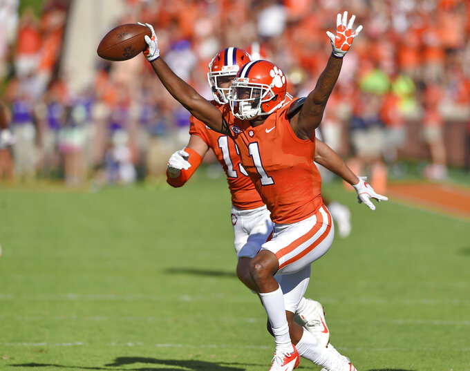 Clemson's Trayvon Mullen reacts after making an interception during the first half of an NCAA college football game against Boston College, Saturday, Sept. 23, 2017, in Clemson, S.C. (AP Photo/Richard Shiro)
