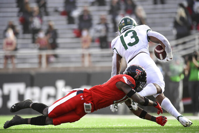 Baylor running back Qualan Jones (13) is tripped by Texas Tech defensive back Eric Monroe during the first half of an NCAA college football game in Lubbock, Texas, Saturday, Nov. 14, 2020. (AP Photo/Justin Rex)