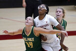 Stanford forward Francesca Belibi, center, battles for a rebound against Cal Poly forward Hannah Scanlan (14) and Ivana Nikolova during the first half of an NCAA college basketball game in Stanford, Calif., Wednesday, Nov. 25, 2020. (AP Photo/Tony Avelar)