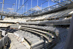 The east side of SoFi Stadium is under construction in Inglewood, Calif., on Wednesday, Jan. 22, 2020. The estimated $5 billion project is on schedule to open in July as the most expensive stadium in NFL history. (AP Photo/Greg Beacham)