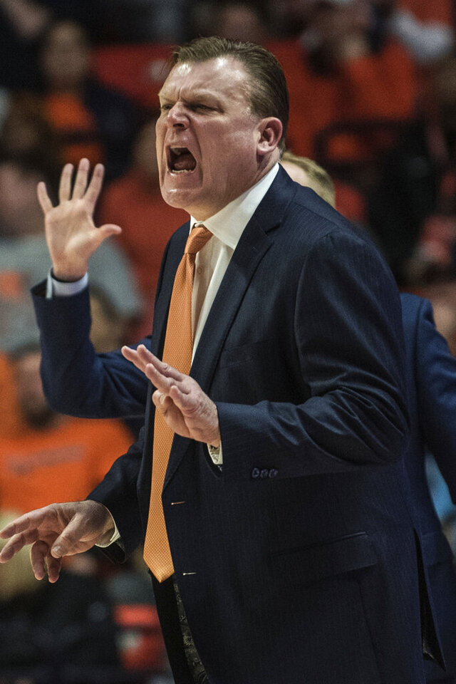 Illinois head coach Brad Underwood talks to his team as they take on Indiana in the first half of an NCAA college basketball game Sunday, March 1, 2020, in Champaign, Ill. (AP Photo/Holly Hart)